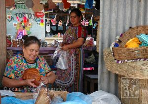 Two women selling bread.