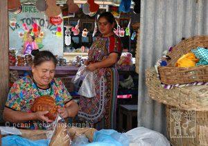 Two women selling bread.