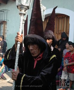 Devotion, this man has been apart of the processions during Easter since he was a little boy.