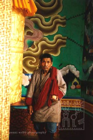 54. Man w golden prayer wheel wm.jpg