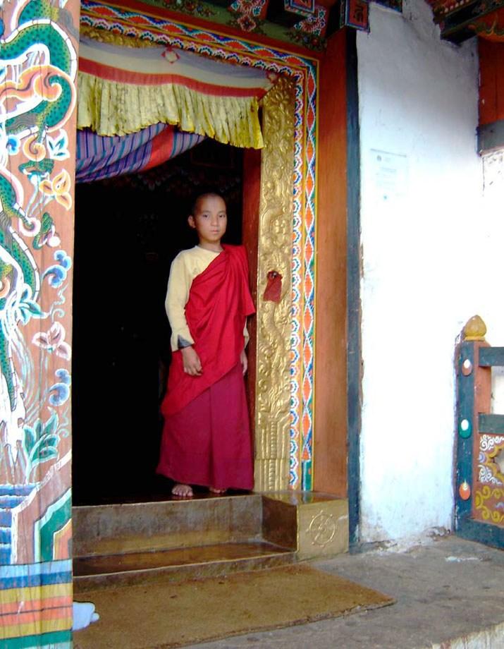 Boy Monk in doorway