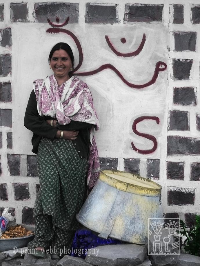 Hindu woman by Wall