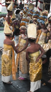 Bali Girls Playing before a Performance. Hand Tinted Photograph